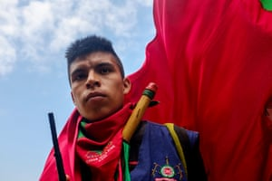 A young member of the Nasa Indigenous Guard mans a radio on the back of a truck during a minga (community mobilisation) to clear sugar cane monoculture in the Munchique Los Tigres reserve.