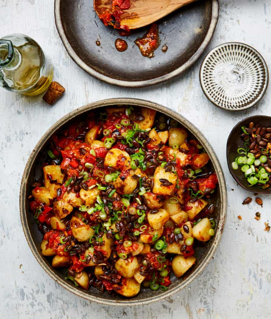 Yotam Ottolenghi's potato salad with charred tomato and orange sauce.