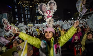 Supporters of Democratic Progressive Party (DPP) presidential candidate Tsai Ing-wen shout during rally campaign ahead of the Taiwanese presidential election.