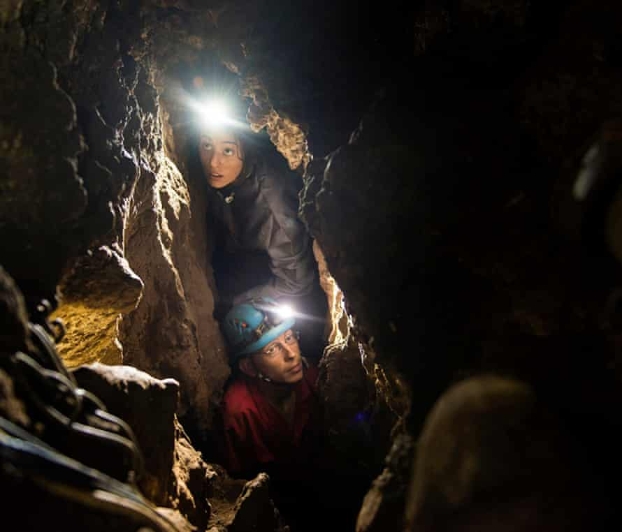 Lee Bergen's daughter Megan and underground exploration team member Rick Hunter navigate the narrow chutes leading to the Dinaledi chamber.