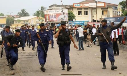 Riot police disperse crowds in Kinshasa, the Democratic Republic of the Congo