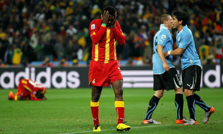 Asamoah Gyan reacts after missing his last-gasp penalty kick.