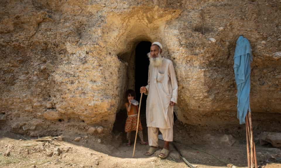 Shah Mast, 90, in the doorway to his cave home.
