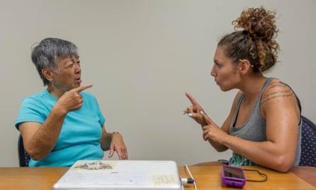 Linda Lambrecht, left, teaches Hawaii Sign Language.