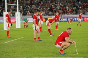 Wales' prop Dillon Lewis and teammates dejected.