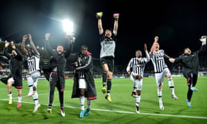 Gianluigi Buffon leads the Juventus celebrations in Florence after their 2-1 victory over Fiorentina.