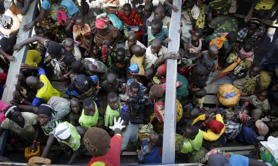 Refugees who fled Burundi wait at Kagunga on Lake Tanganyika, Tanzania, in May 2015.