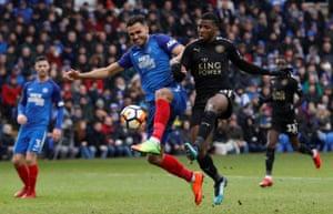 Leicester City's Kelechi Iheanacho shoots past Peterborough United's Ryan Tafazolli as City go on to win 5-1 at the ABAX Stadium.