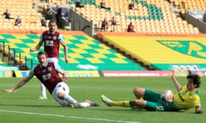 Burnley's Chris Wood (left) goes down inside the box following a challenge from Norwich City's Timm Klose however no penalty is given.