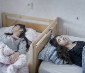 People – singles, first prize. Djeneta, right, has been bedridden and unresponsive for two and a half years, and her sister Ibadeta for more than six months, in Horndal, Sweden. The sisters are Roma refugees from Kosovo who have resignation syndrome, which renders patients immobile, mute and unable to respond to physical stimulus
