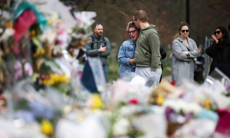 Mourners gather at Clapham Common after the death of Sarah Everard in London