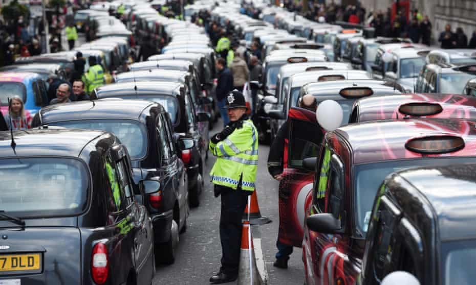 Black taxi drivers block London's Whitehall in 2016 in protest at TfL's granting Uber a licence to operate in London.