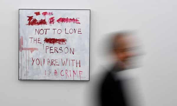 A visitor walks past No Love at the launch of A Fortnight of Tears.