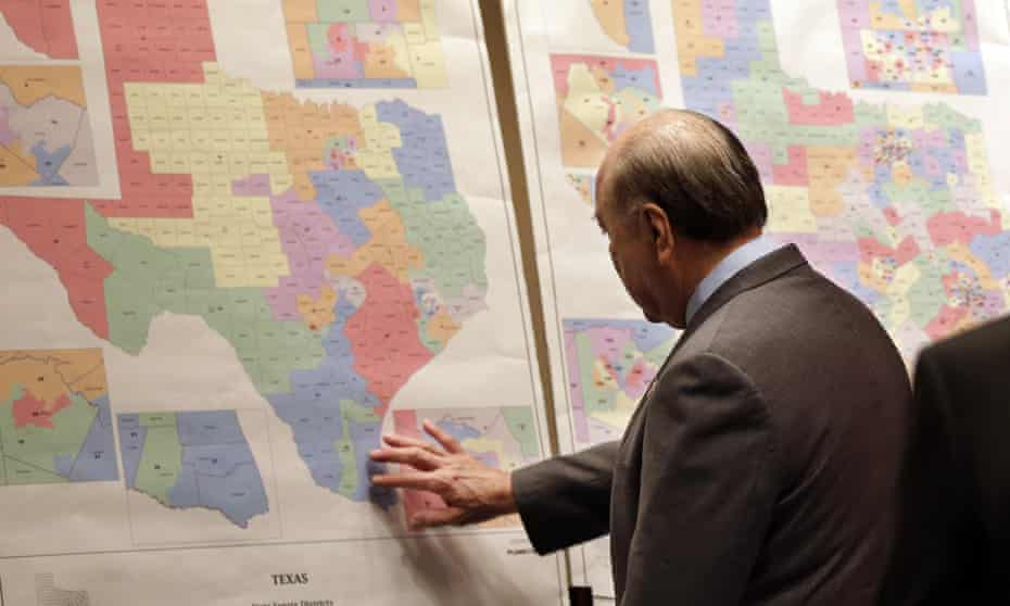 Texas state senator Juan 'Chuy' Hinojosa looks at maps on display prior to a senate redistricting committee hearing, in Austin, Texas, in 2013 during the last redistricting cycle.