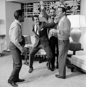 Sammy Davis Jr., Dean Martin, Frank Sinatra, and Joey Bishop stage a fight on the Warner Brothers set of Ocean's Eleven in 1960.