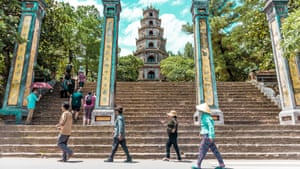 Four people walk in front of the Thien Mu Pagoda in Huế, Vietnam in a shot the photographer feels evoked the spirit of the famous photograph of The Beatles crossing Abbey Road in London.
