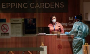 Staff members are seen inside the Epping Gardens Aged Care Facility in Melbourne, Australia.