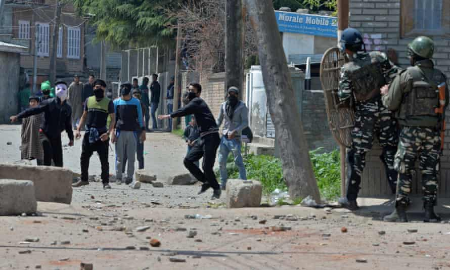 Kashmiri protesters clash with Indian security forces near a polling station on Sunday.