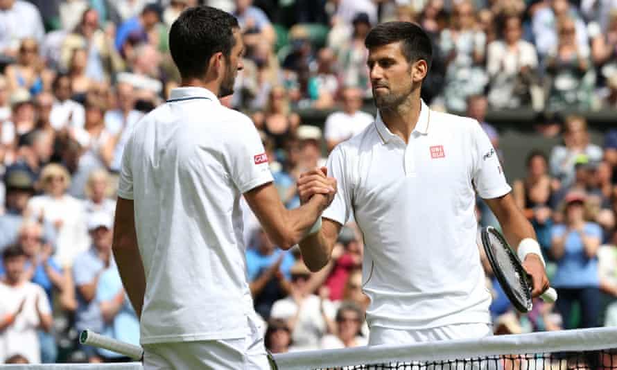 Novak Djokovic clasps hands with James Ward after their match
