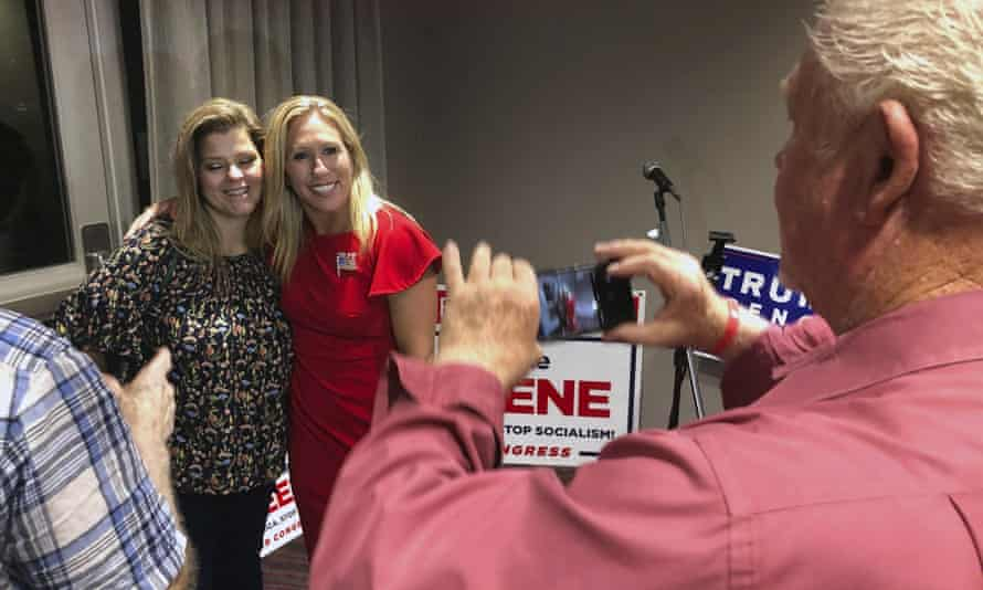 Supporters take photos with Marjorie Taylor Greene, background right, in Rome, Georgia, this month.
