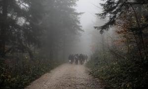 Migrants walk through the woods towards Vucjak camp near Bihac, Bosnia and Herzegovina, 14 November 2019.