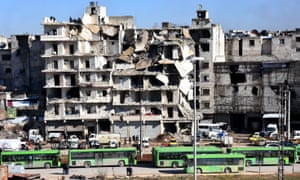 Buses waiting to evacuate people from rebel-held neighbourhoods in Aleppo
