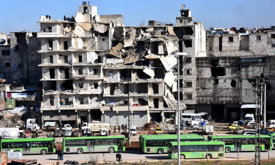 Buses waiting to evacuate people from rebel-held neighbourhoods in Aleppo