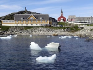 Small pieces of ice float in the water off Nuuk, the capital of Greenland