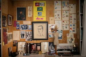 drawings and photographs on a wall at the yves saint laurent museum in paris