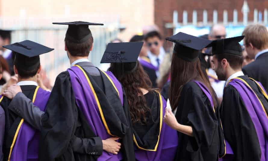 Students from the London School of Economics wear mortar boards and gowns during a ceremony for university graduates in London,