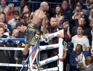 Conor McGregor vs Floyd Mayweatherepaselect epa06165780 Floyd Mayweather (C) of the US climbs the ring ropes to celebrate his win against Conor McGregor (not pictured) of Ireland during their fight for the WBC 'Money Belt' at the T-Mobile Arena in Las Vegas, Nevada, USA, 26 August 2017. EPA/ARMANDO ARORIZO