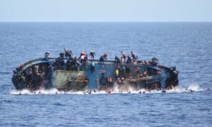 An overcrowded boat about to capsize in the Mediterranean