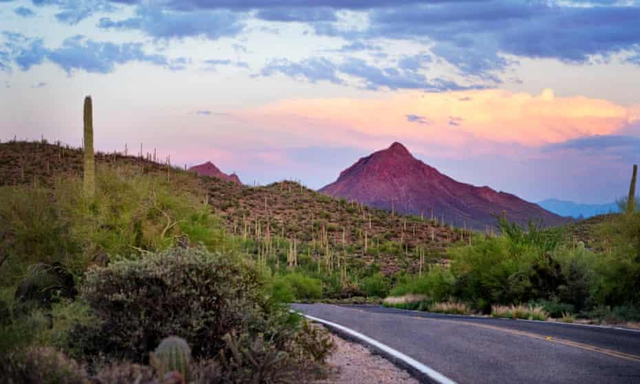 Tucson Arizona, desert highway sunset.