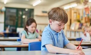 Children writing at desks