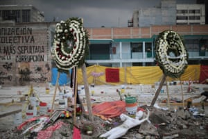 Wreaths and the personal objects of the people who died have been placed in the collapsed sewing factory at Colonia Obrera six days after the magnitude 7.1 earthquake.