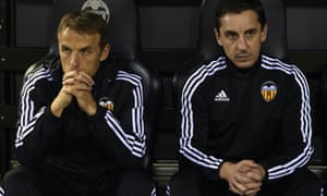 Phil Neville, left, has been left isolated by the sacking of his brother Gary, right.