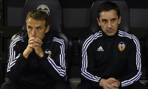 Gary Neville, right, and his brother Phil saw Valencia win the Copa del Rey second leg 2-0 against Barkaldo to go through 5-1 on aggregate.