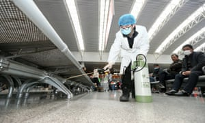 A worker disinfects a railway station in Nanchang City, Jiangxi province, China.