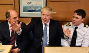 Boris Johnson with defence secretary Ben Wallace, left, meeting crew members of the HMS Victorious in Faslane, Scotland.