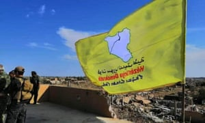 The yellow flag of US-backed Kurdish Syrian Democratic Forces being raised in Baghuz after declaring victory over Isis in March 2019.