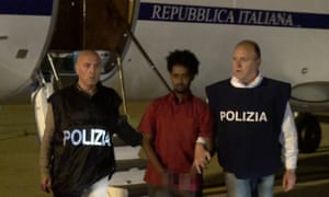 Italian police with the arrested man in 2016. Prosecutors say he is the alleged trafficker Medhanie Yehdego Mered, but he is apparently refugee Medhanie Tesfamariam Berhe.