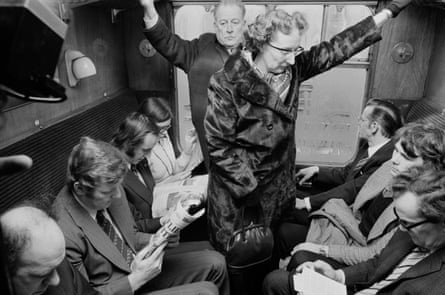 Commuters on a rush-hour train in London, 1975