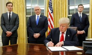 Jared Kushner stands beside vice-president Mike Pence as Donald Trump signs his first executive orders on inauguration day.