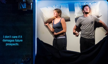 Captions are projected on to the bed, which the audience sees as if from above, in The Solid Life Of Sugar with Arthur Hughes and Genevieve Barr.