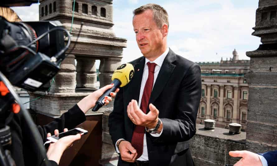 Interior minister Anders Ygeman faces the media as he comments on his resignation.