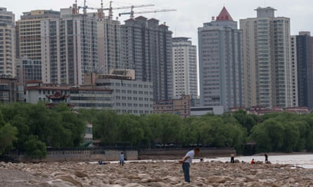 Skyscrapers under construction along the shore of the Yellow river in Lanzhou, China