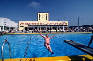 The swimming pool at the Skegness Butlin's, overlooked by a building emblazoned with the phrase: 'Our true intent is all for your delight', a quote from Shakespeare's A Midsummer Night's Dream