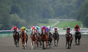 Sophie Doyle on Lang Shining (second left in yellow/green) comes through to win the Breeders' Cup Live On At The Races Claiming Stakes at Lingfield in 2010.