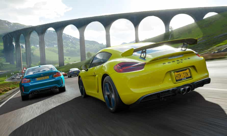 A Porsche takes on a BMW on a typically picturesque stretch of road