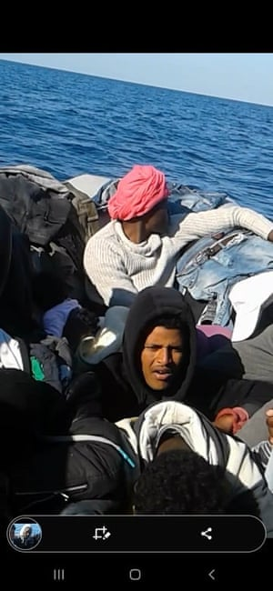 A photograph taken aboard a dingy that was allegedly pushed back by Malta to Libya.